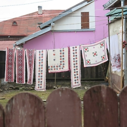 Embroidered fabrics drying in a yard in the former Jewish neighborhood of Gura Humorului. CREDIT: Timothy Ryan Mendenhall