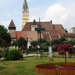 The central square in Medias with the Saxon protestant church (Margarethenkirche) and defense towers in the background. CREDIT: Timothy Ryan Mendenhall