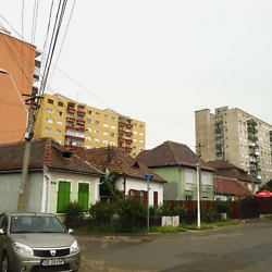 Communist-era block apartments alongside traditional homes in Medias. CREDIT: Timothy Ryan Mendenhall