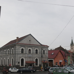 View of the former synagogue in Reghin, with the German church farther down the street. CREDIT: Benjamin Fox-Rosen.