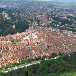 View of the old town taken from the hill with the Brasov sign. CREDIT: Timothy Ryan Mendenhall